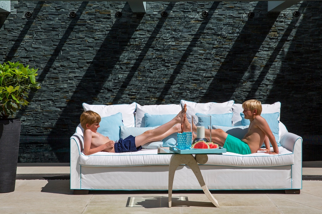 kids playing on luxury outdoor sofa